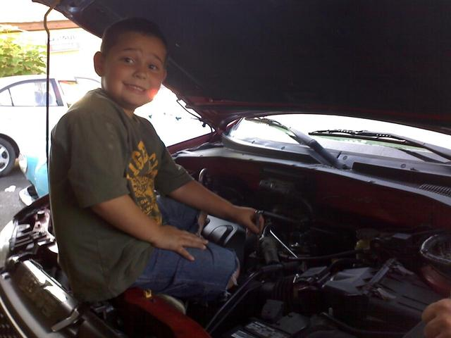Devin helping Dad at the shop