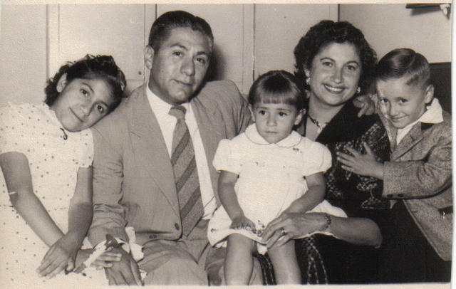 My Mom, Dad, Mario, Laura - that's me, leaning on my Dad's shoulder!